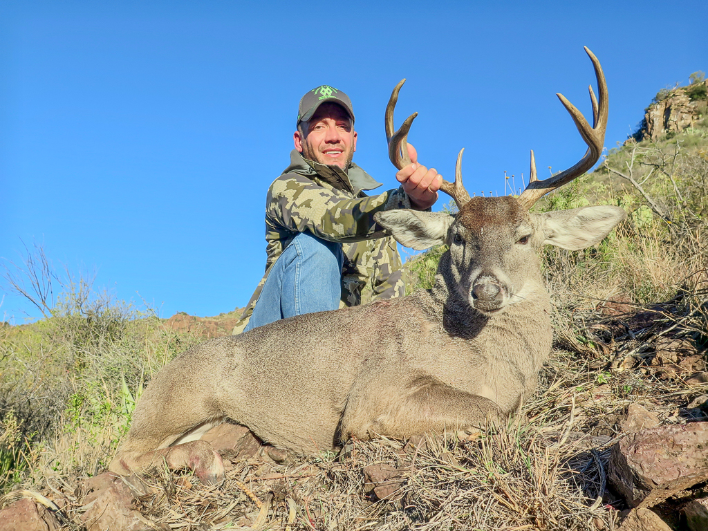 Wes Mundy - Top Texas Hunting Outfitter - holding Carmen Mountain Whitetail Deer