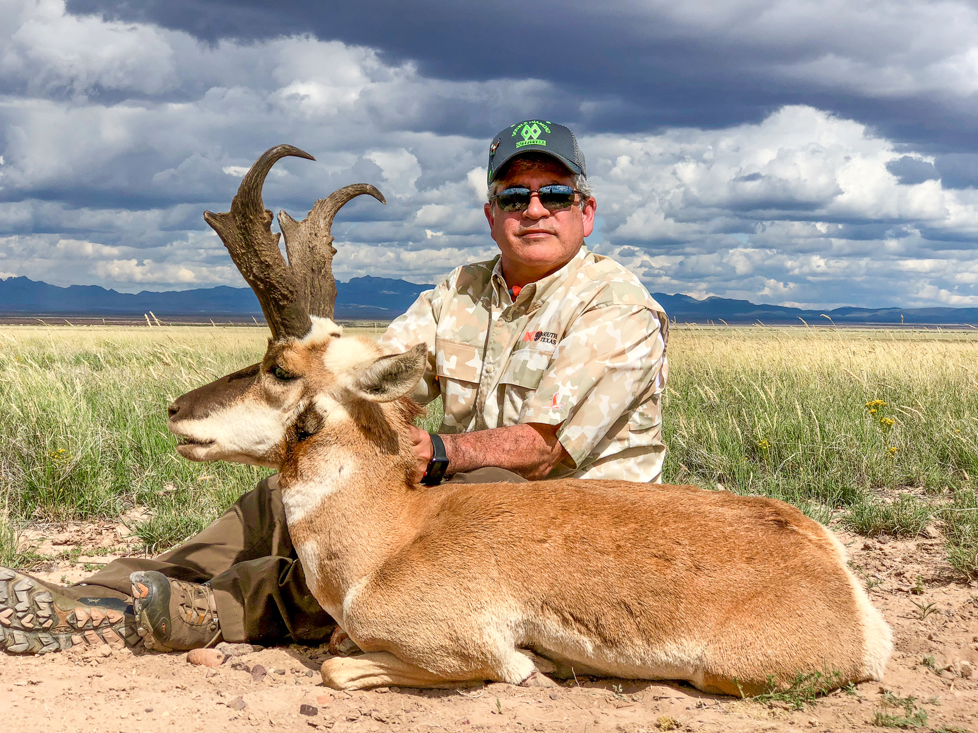 Texas Hunter holding dead Pronghorn