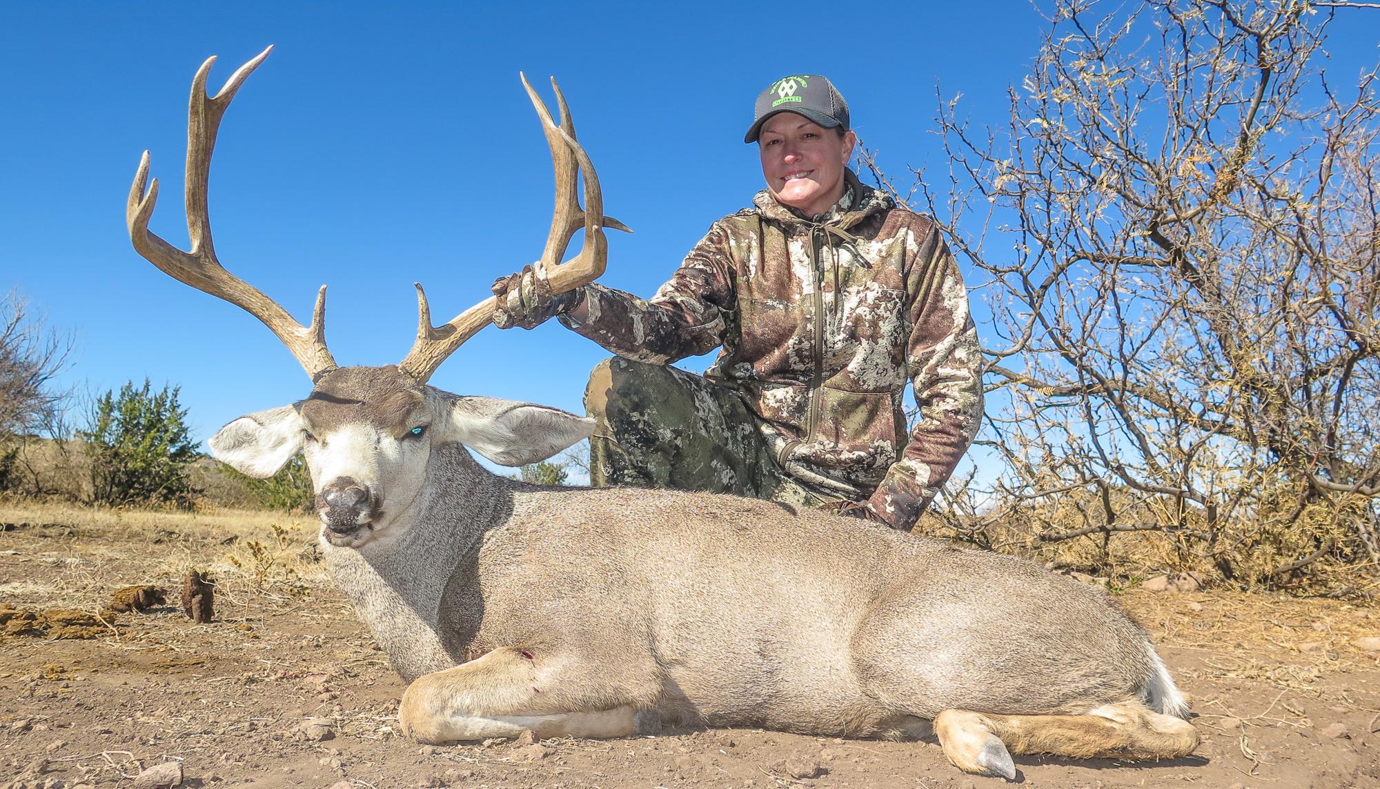 Texas Mule Deer Hunting - Hunter holding dead Mule Deer